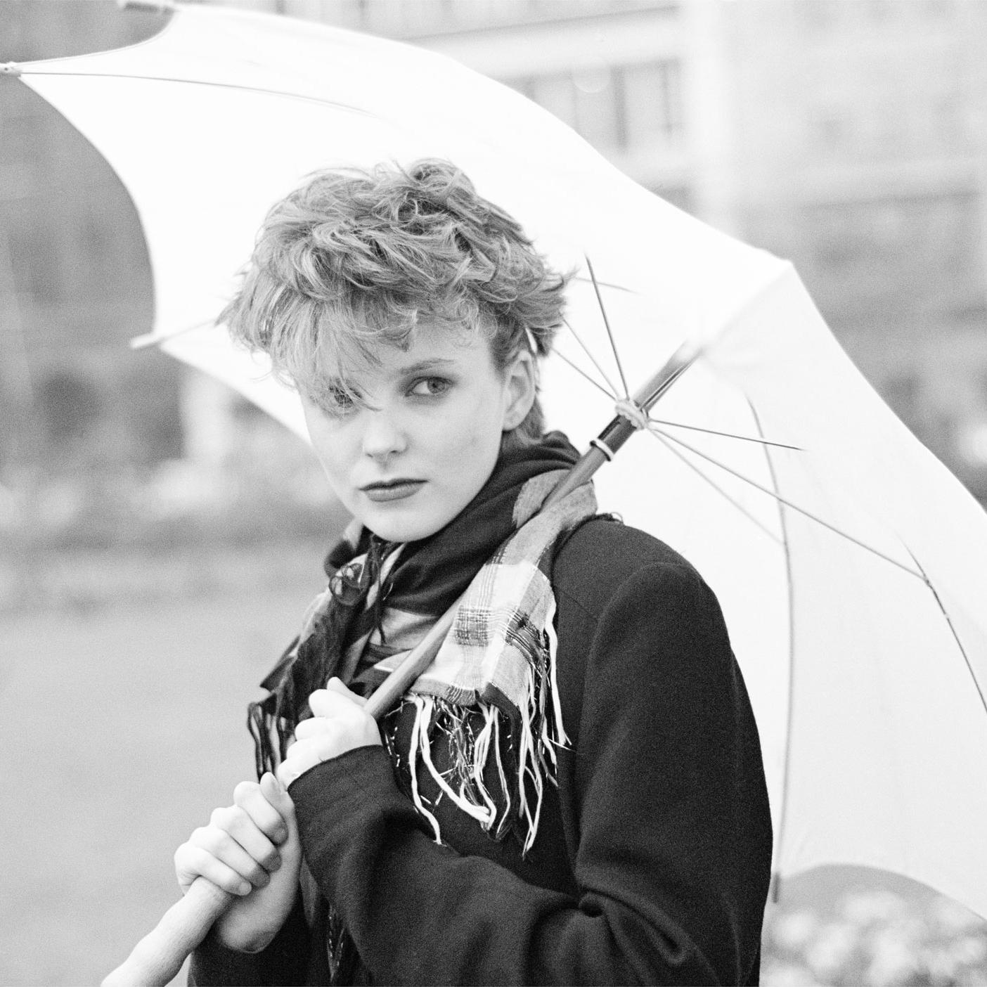 Image of Claire Grogan (with Umbrella) by Harry Papadopoulos